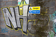 NHS street art graffiti in Digbeth, Birmingham, England, United Kingdom. Digbeth is an area of Central Birmingham, England. Following the destruction of the Inner Ring Road, Digbeth is now considered a district within Birmingham City Centre. As part of the Big City Plan, Digbeth is undergoing a large redevelopment scheme that will regenerate the old industrial buildings into apartments, retail premises, offices and arts facilities. There is still however much industrial activity in the south of the area.