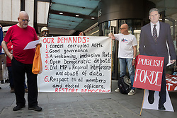 Roger Silverman (l) prepares to address supporters of left-wing Labour Party groups at a protest lobby outside the party's headquarters on 20th July 2021 in London, United Kingdom. The lobby was organised to coincide with a Labour Party National Executive Committee meeting during which it was asked to proscribe four organisations, Resist, Labour Against the Witchhunt, Labour In Exile and Socialist Appeal, members of which could then be automatically expelled from the Labour Party.