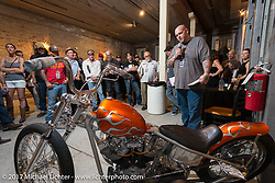 Custom builder Ryan Gore in the In Motion invitational bike show build to other builders and judges during the Lone Star Rally. Galveston, TX. USA. Friday November 3, 2017. Photography ©2017 Michael Lichter.