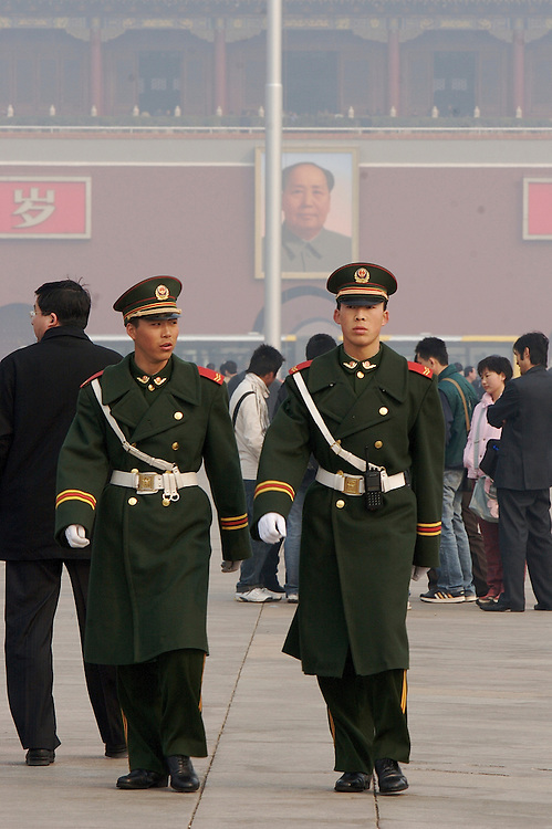 Soldiers at Tiananmen march up and down the center line of the Square while on duty in Beijing,China.