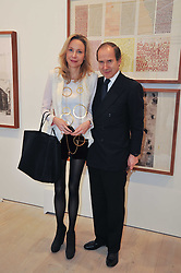 SIMON DE PURY and his wife MICHAELA NEUMEISTER at a private view of work by Brian Clarke - Works on Paper 1969-2011 held in the Phillips de Pury Galleries, The Saatchi Gallery, London on 28th February 2011.