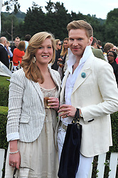 HENRY CONWAY and his sister CLAUDIA CONWAY at a charity polo match organised by Jaeger Le Coultre was held at Ham Polo Club, Richmond, Surrey on 12th June 2009.