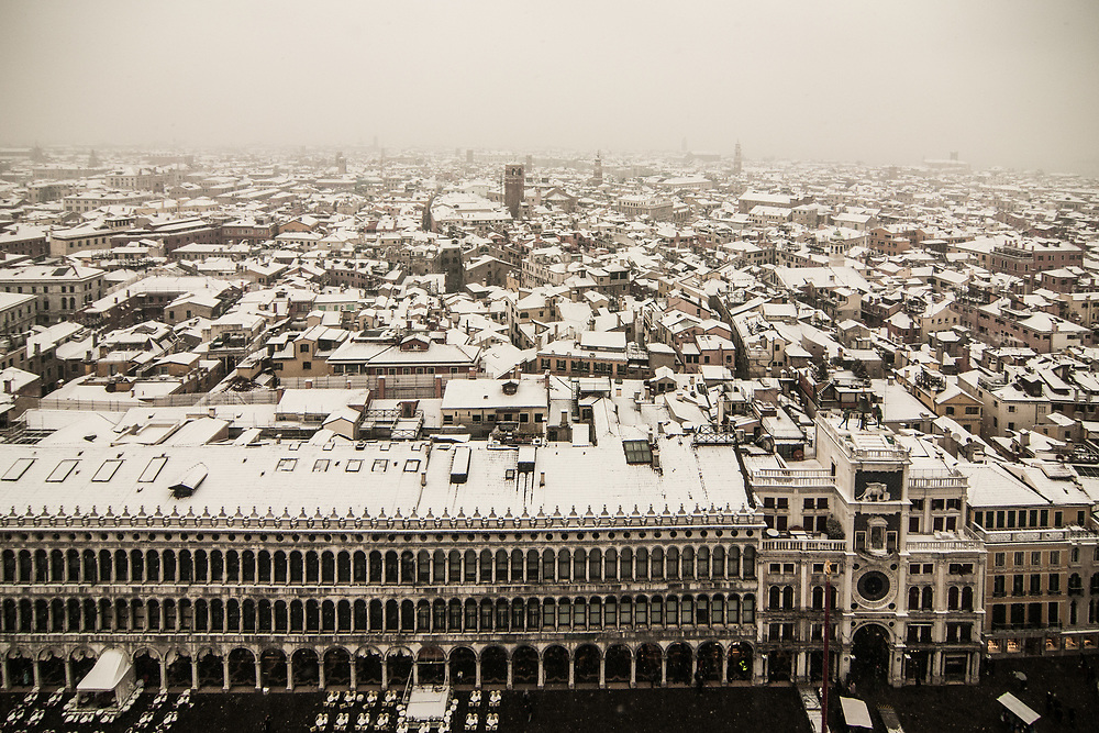 """VENICE, ITALY - 28th FEBRUARY/01st MARCH 2018<br /> Snow covered roofs in Venice, Italy. A blast of freezing weather called the """"Beast from the East"""" has gripped most of Europe in the middle of winter of 2018, and in Venice A snowfall has covered the city with white, making it fascinating and poetic for citizen and tourists.   © Simone Padovani / Awakening"""