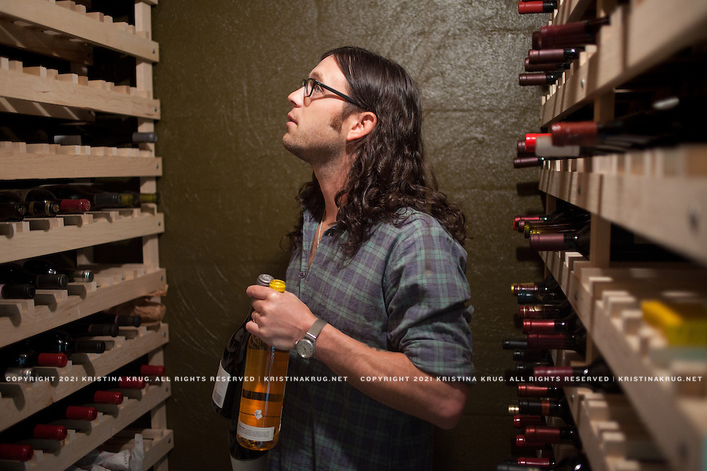 """Featured in Wine Spectator. Nathan Followill in his 500 bottle wine cellar; a """"cave"""", carved into a limestone hill."""