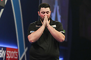 Luke Humphries wins his third round match against Dimitri Van den Bergh and celebrates during the World Darts Championships 2018 at Alexandra Palace, London, United Kingdom on 27 December 2018.