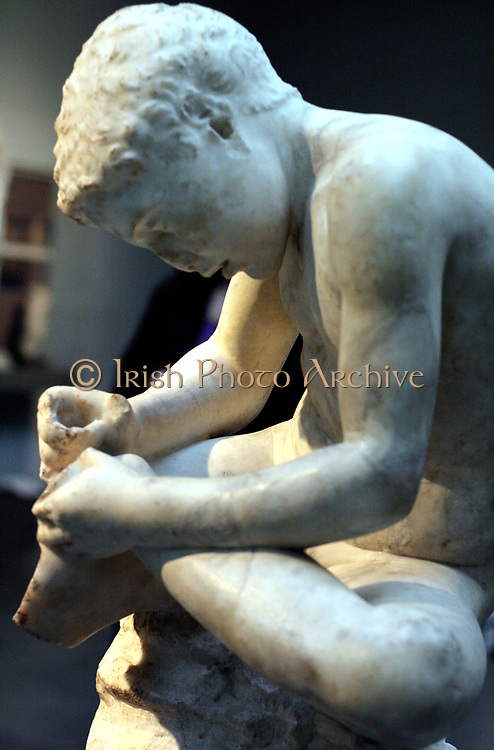 Marble statue of a boy, also known as the 'spinario', or thorn-puller. circa 25-50 AD, Roman copy of a lost Hellenistic work from 3rd century BC.