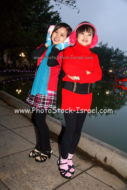 Hanoi, Vietnam, two female teens