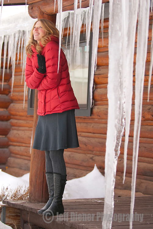 A young woman braces against the cold in Jackson Hole, Wyoming.