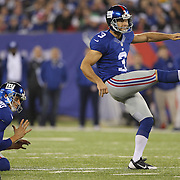 Steve Weatherford, New York Giants, holding for kicker Josh Brown during the New York Giants Vs Green Bay Packers, NFL American Football match at MetLife Stadium, East Rutherford, New Jersey, USA. 17th November 2013. Photo Tim Clayton