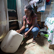 Margarita pours a glass of water for one of her seven children, from a jug stored in the bedroom of their home in the la Cubana area of San Pedro Province in the Dominican Republic, September 12, 2017. The area was not badly hit by Hurricane Irma, though it is prone to diseases, especially now in the rainy season with increased rainfall during the hurricane. Several areas with stagnant water are breeding grounds for mosquitos, increasing cases of dengue, chikungunya, zika and others. stands with two of her seven children in front of their house in the la Cubana area of San Pedro Province in the Dominican Republic, September 12, 2017. The area was not badly hit by Hurricane Irma, though it is prone to diseases, especially now in the rainy season with increased rainfall during the hurricane. Several areas with stagnant water are breeding grounds for mosquitos, increasing cases of dengue, chikungunya, zika and others. The only drinking water available is bought, consuming a large percentage of their weekly budget.