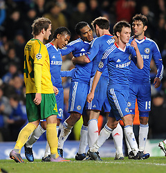 23.11.2010, Stamford Bridge, London, ENG, UEFA CL, Chelsea FC vs MSK Zilina, im Bild Chelsea`s Florent Malouda  celebrates scoring his sides second goal with team-mates  Chelsea vs MSK Zilina  for the  Uefa Champions Premier League, Group H,  at Stamford Bridge stadium in London on 23/11/2010. EXPA Pictures © 2010, PhotoCredit: EXPA/ IPS/ Rob Noyes +++++ ATTENTION - OUT OF ENGLAND/UK and FRANCE/FR +++++
