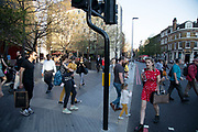 Busy street scene on Tooley Street with people coming and going after work in London, England, United Kingdom.