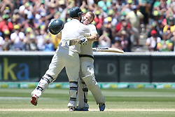 © Licensed to London News Pictures. 29/12/2013. Chris Rogers celebrates his 100 runs by hugging Shane Watson during Day 4 of the Ashes Boxing Day Test Match between Australia Vs England at the MCG on 29 December, 2013 in Melbourne, Australia. Photo credit : Asanka Brendon Ratnayake/LNP
