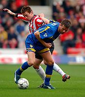 Photo. Richard Lane<br />Southampton v Leeds United. Barclaycard Premiership 19/04/2003.<br />Eirik Bakke is challenged by Matt Oakley