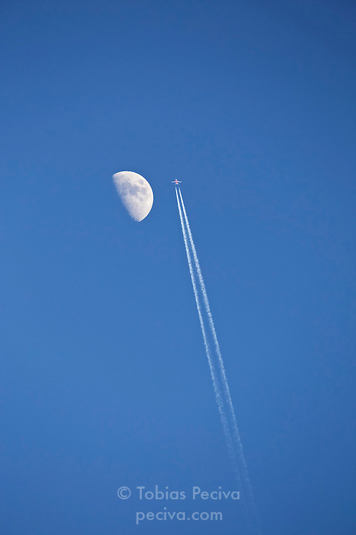 Southwest Boeing 737 cruises past the moon in the clear skies above White Sands National Monument, New Mexico.