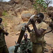 May 02, 2012 - Kauda, Nuba Mountains, South Kordofan, Sudan: Sudan People's Liberation Movement (SPLA-N) rebel fighters take defensive positions in Jebel Kwo military base, ahead of an attack on Sudan's Armed Forces (SAF) positions near Tess village in the rebel-held territory of the Nuba Mountains in South Kordofan. SPLA-North, a historical ally of SPLA, South Sudan's former rebel forces, has since last June being fighting the Sudanese Army Forces (SAF) over the right to autonomy and of the end of persecution of Nuba people by the regime of President Bashir.