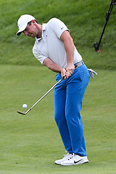 June 21, 2018 - Cromwell, Connecticut, United States - CROMWELL, CT-JUNE 21: Rory McIlroy chips on to the 18th green during the first round of the Travelers Championship on June 21, 2018 at TPC River Highlands in Cromwell, Connecticut. (Credit Image: © Debby Wong via ZUMA Wire)