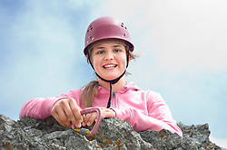 Climber girl young mountains holding carabiner
