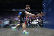 Mathieu Castagnet of France (wearing Black shirt) hits a shot against Omar Mosaad of Egypt (wearing light Blue shirt) the Final, Omar Mosaad of Egypt v Mathieu Castagnet of France , Canary Wharf Squash Classic 2016 , at the East Wintergarden in Canary Wharf , London on Friday 11th March 2016.<br /> pic by John Patrick Fletcher, Andrew Orchard sports photography.