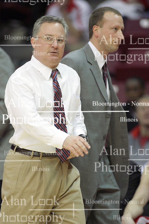 02 February 2013:  Barry Hinson gets walked out with about 1 mite to go after the SIU bench gets two technicals and he is ejected during an NCAA Missouri Valley Conference mens basketball game where the Salukis of Southern Illinois lost to the Illinois State Redbirds for Retro-Night 83-47 in Redbird Arena, Normal IL