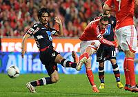 20120331: LISBON, PORTUGAL - Portuguese Liga Zon Sagres 2011/2012 - SL Benfica vs CS Braga.<br /> In picture: Benfica's forward Bruno Cesar, right, shoots the ball.<br /> PHOTO: Alvaro Isidoro/CITYFILES