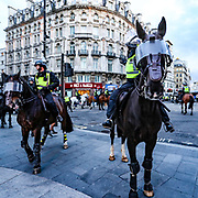 British mounted cavalry police officers try to contain members of the Black Lives Matter movement during a protest at Piccadilly Circus in central London, Saturday, June 13, 2020. British police have imposed strict restrictions on groups protesting in London Saturday in a bid to avoid violent clashes between protesters from the Black Lives Matter movement, as well as far-right groups that gathered to counter-protest.<br /> Anger against systemic levels of institutional racism has raged through the city, and worldwide; sparked by the death of George Floyd, who was killed in Minneapolis, US, by a policeman who restrained him with force on 25 May 2020. (Photo/ Vudi Xhymshiti)