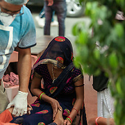 1 May 2021<br /><br />Indirapuram, Gazhiabad<br />Volunteers  attempt to revive a patient who had stopped breathing while relatives watch in desperation at the Indirapuram Gurudwara ( Sikh Temple) where a free oxygen camp has been organised for Covid positive patients who have not found a hospital or oxygen support . A massive spike in cases caught the administration and hopsitals unprepared , this  in the national capital region. Lack of hospital beds , oxygen and ICU facilities has meant good samaritans are stepping up and trying to fill the gaps. 1 May 2021<br /> <br /> Indirapuram, Gazhiabad<br /> Volunteers attempt to revive a patient ( Vishal) who had passed out with a very low pulse while his wife clings to his foot in desperation at the Indirapuram Gurudwara ( Sikh Temple). The temple has a free oxygen facility  for Covid positive patients who have not found a hospital or oxygen support . The camp under a cloth tent on the road is a makeshift setup without proper medical support. As a result when Vishals  condition worsened they had no option but to send the family to the nearest emergency ward of a hospital to try getting help. Vishal was put into the families car barely breathing ( most likely dead but cannot be confired).