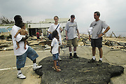 Victims of Hurricane Katrina survey the damage in Bay St. Louis pictured after Hurricane Katrina blew through town Thursday Sept. 1,2005.Katrina is the worst storm to ever hit American soil in history.(Photo/SuziAltman)