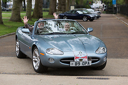 © Licensed to London News Pictures. 27/04/2014. London, UK. Driver wave as they leave in a vintage Jaguar car. Around 250 vintage Jaguar cars set off in a staggered start from the Old Royal Naval College in Greenwich, south east London for the 16th annual London to Brighton rally this morning. Photo credit : Vickie Flores/LNP