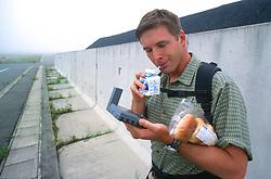 J. Nichols Checking GPS and Drinking Milk!