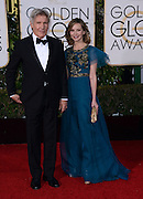 HARRISON FORD + CALISTA FLOCKHARD @ the 73rd Annual Golden Globe awards held @ the Beverly Hilton hotel.<br /> ©Exclusivepix Media