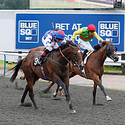 Attraction Ticket and Adam Beschizza winning the 4.10 race