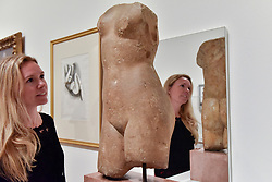 """© Licensed to London News Pictures. 01/08/2017. London, UK. A staff member views a 1st or 2nd century Roman """"Female torso"""". Preview of """"Matisse in the Studio"""", at the Royal Academy of Arts, Piccadilly, the first exhibition to consider how the personal collection of treasured objects of Henri Matisse were both subject matter and inspiration for his work.  Around 35 objects are displayed alongside 65 of Matisse's paintings, sculptures, drawings, prints and cut-outs.  The exhibition runs 5 August to 12 November 2017.  Photo credit : Stephen Chung/LNP"""