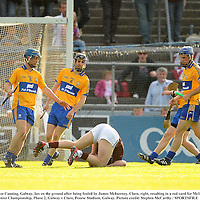 2 July 2011; Joe Canning, Galway, lies on the ground after being fouled by James McInerney, Clare, right, resulting in a red card for McInerney. GAA Hurling All-Ireland Senior Championship, Phase 2, Galway v Clare, Pearse Stadium, Galway. Picture credit: Stephen McCarthy / SPORTSFILE