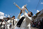 A brass band parades through Paracho, Michoacan state, Mexico on August 10, 2008 during the annual Feria Internacional de la Guitarra. Parades for different professions are held each day of the week-long festival, culminating in the parade of the guitar makers.