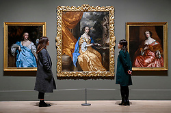 "© Licensed to London News Pictures. 03/02/2020. LONDON, UK. Staff members view three works by Peter Lely, including (C) ""Anne Hyde, Duchess of York"", c1661. Preview of ""British Baroque : Power and Illusion"", the first ever exhibition to focus on baroque culture in Britain.  Works from the Restoration of Charles II in 1660 to the death of Queen Anne in 1714 are on display at Tate Modern 4 February to 19 April 2020, many on show to the public for the first time.  Photo credit: Stephen Chung/LNP"