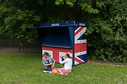 Two ladies arrive early at the Royal Ascot horseracing festival for an early picnic in a grassy car park. Royal Ascot is one of Europe's most famous race meetings, and dates back to 1711. Queen Elizabeth and various members of the British Royal Family attend. Held every June, it's one of the main dates on the English sporting calendar and summer social season. Over 300,000 people make the annual visit to Berkshire during Royal Ascot week, making this Europe's best-attended race meeting with over £3m prize money to be won.