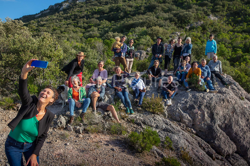 Group of family and friends having their portrait taken on a summers evening on a mobile phone as a selfie on a mountain 5th October 2019 in the village of Terme, France.
