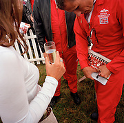 Lady groupies collect autographs to pilots the 'Red Arrows', Britain's Royal Air Force aerobatic team during air show.
