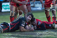 Chris Dean of Edinburgh ®  scores a try as Nick Crosswell of the Newport Gwent Dragons tries to prevent the ball grounding. Guinness Pro12 rugby match, Newport Gwent Dragons  v Edinburgh rugby at Rodney Parade in Newport, South Wales on Sunday 27th November 2016.<br /> pic by Simon Latham, Andrew Orchard sports photography.