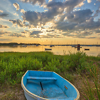 Enchanted Evening - Cape Cod fine art photography of a blue dinghy framed by the beautiful sunset light and cloudscape at the Dimmick Waterfront Scenic Vista in Bourne, MA.<br />
