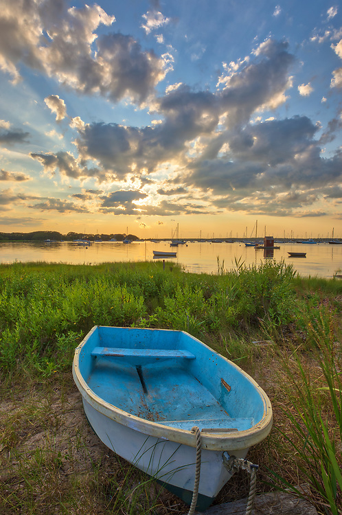 Enchanted Evening - Cape Cod fine art photography of a blue dinghy framed by the beautiful sunset light and cloudscape at the Dimmick Waterfront Scenic Vista in Bourne, MA.<br />   <br /> Cape Cod fine art photography is available as museum quality photography prints, canvas prints, acrylic prints or metal prints. Fine art prints may be framed and matted to the individual liking and decorating needs:<br /> <br /> https://juergen-roth.pixels.com/featured/enchanted-evening-juergen-roth.html<br /> <br /> All Cape Cod digital photography image licensing is available at www.RothGalleries.com. Please contact Juergen with any questions or request. <br /> <br /> <br /> Good light and happy photo making!<br /> <br /> My best,<br /> <br /> Juergen<br /> Licensing: http://www.rothgalleries.com<br /> Instagram: https://www.instagram.com/rothgalleries<br /> Twitter: https://twitter.com/naturefineart<br /> Facebook: https://www.facebook.com/naturefineart