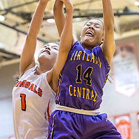 Gallup Bengal Ashley Antone (1), left, misses a rebound claimed by Kirtland Central Bronco Shayonna Begay (14) in the District 1-5A girls tournament at Gallup High School Thursday.