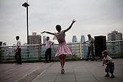 A woman dances in a public square in Qongqing China.