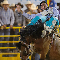 Bareback rider Kyle Charley makes a winning 85-point ride during the Navajo Nation Fair Rodeo Friday in Window Rock.