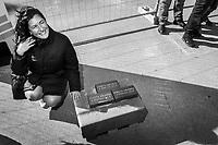 CASTELVOLTURNO (CE) - 3 FEBBRAIO 2018: Una donna si mette in posa con i mattoni usati per la posa della prima pietra all'evento di apertura del cantiere per l'ampliamento della struttura ospedaliera dell'Ospedale Pineta Grande di Castelvolturno, inaugurato da Vincenzo De Luca (Partito Democratico), Presidente della Regione Campania ed ex sindaco di Salerno, a Castelvolturno (CE) il 3 febbraio 2018.<br /> <br /> Le elezioni politiche italiane del 2018 per il rinnovo dei due rami del Parlamento – il Senato della Repubblica e la Camera dei deputati – si terranno domenica 4 marzo 2018. Si voterà per l'elezione dei 630 deputati e dei 315 senatori elettivi della XVIII legislatura. Il voto sarà regolamentato dalla legge elettorale italiana del 2017, soprannominata Rosatellum bis, che troverà la sua prima applicazione<br /> <br /> ###<br /> <br /> CASTELVOLTURNO, ITALY - 3 FEBRUARY 2018: A woman poses for a picture with the brick used for the laying of the first stone at the inauguration event for the opening of the construction site for the extension of the Pineta Grande Hospital of Castelvolturno, inaugurated by Vincenzo De Luca (Democratic Party / Partito Democratico), President of the Campania region and former mayor of Salerno, in Castelvolturno, Italy, on February 3rd 2018.<br /> <br /> The 2018 Italian general election is due to be held on 4 March 2018 after the Italian Parliament was dissolved by President Sergio Mattarella on 28 December 2017.<br /> Voters will elect the 630 members of the Chamber of Deputies and the 315 elective members of the Senate of the Republic for the 18th legislature of the Republic of Italy, since 1948.