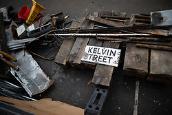 © Licensed to London News Pictures . 06/10/2018. Manchester , UK . Kelvin Street sign amongst the ruins of a part-demolished building on the corner of Thomas Street and John Street , reported to have become dangerous following heavy rains after years of neglect . Campaigners say that the architectural heritage of the Northern Quarter of Manchester City Centre is under threat from developers and Manchester City Council planning policy . Photo credit : Joel Goodman/LNP