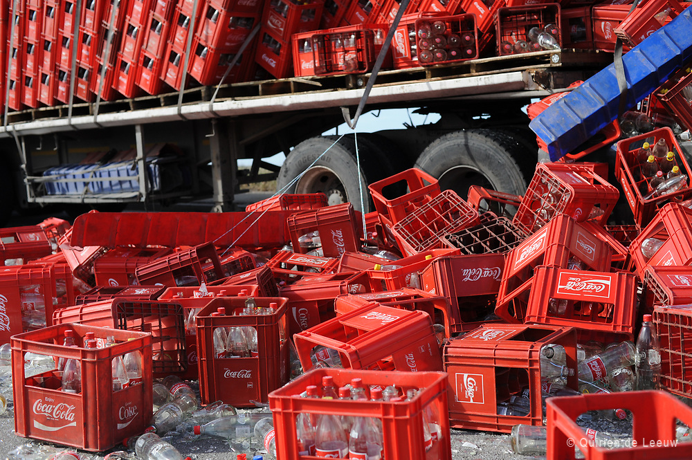 Truck loses Coca cola bottles on Grahamstown Road nearby Motherwell.