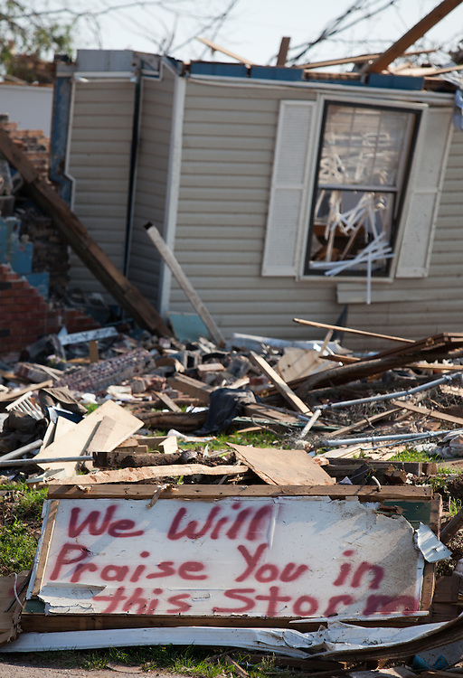 Destoryed home in Tuscaloosa Alabama after being hit by a tornado with a religous message written in front of it on a board . Tuscaloosa was hit by  F-4 and  possibly  F-5 tornados that were part of a storm  of an estimated 300 that struck Alabama and the neighboring states on April 27th , 2011.