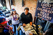 SHOT 12/10/17 12:29:38 PM - Former Buffalo Bills wide receiver and Hall of Fame player Andre Reed signs autographs and meets with fans at LoDo's Bar and Grill in Denver, Co. as the Buffalo Bills played the Indianapolis Colts that Sunday. Reed played wide receiver in the National Football League for 16 seasons, 15 with the Buffalo Bills and one with the Washington Redskins. (Photo by Marc Piscotty / © 2017)